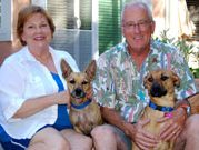 Two dogs and their happy owners at their California home